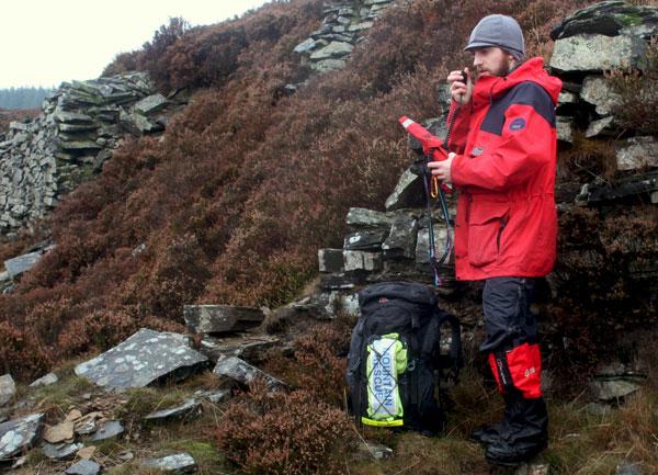 Owen Talks on a radio in the rain